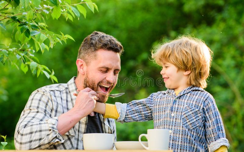 Feed your baby. Natural nutrition concept. Child care. Feeding son natural foods. Feed in right way for childs stage of. Development. Feed son solids. Dad and stock photos
