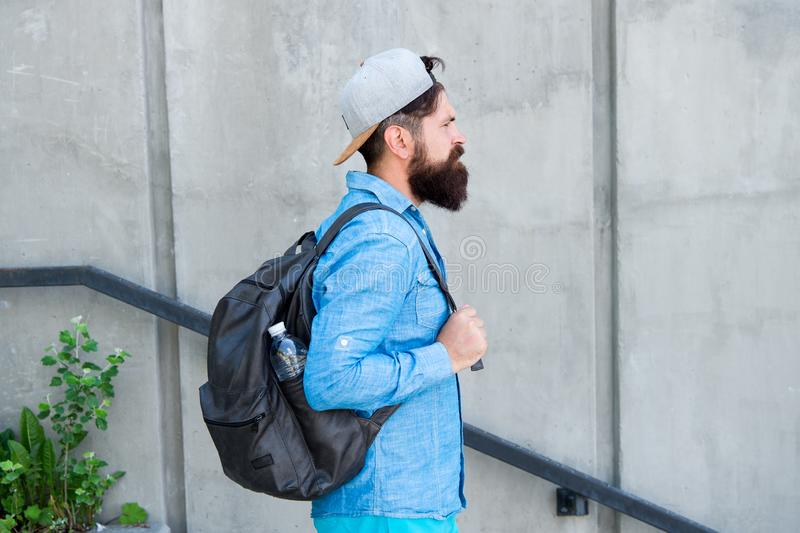 Feed your wanderlust. Mature hipster with beard traveller. Bearded man. Confident brutal man walk street. Male barber royalty free stock photo