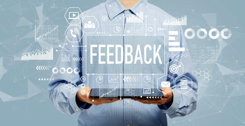 Feedback concept with man holding a tablet royalty free stock images