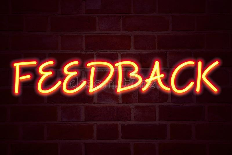 Feedback neon sign on brick wall background. Fluorescent Neon tube Sign on brickwork Business concept for Opinion Information Posi. Tive Negative Feedback 3D royalty free stock image