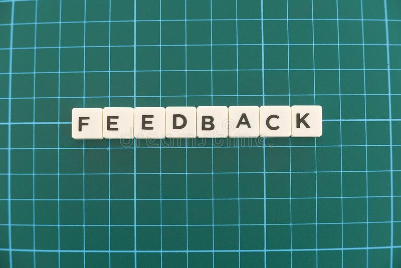 Feedback word made of square letter word on green square mat background. Survey review text communication evaluation opinion business report customer message stock images