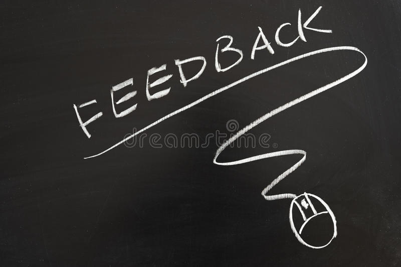Feedback word and mouse symbol. Drawn on the blackboard stock image