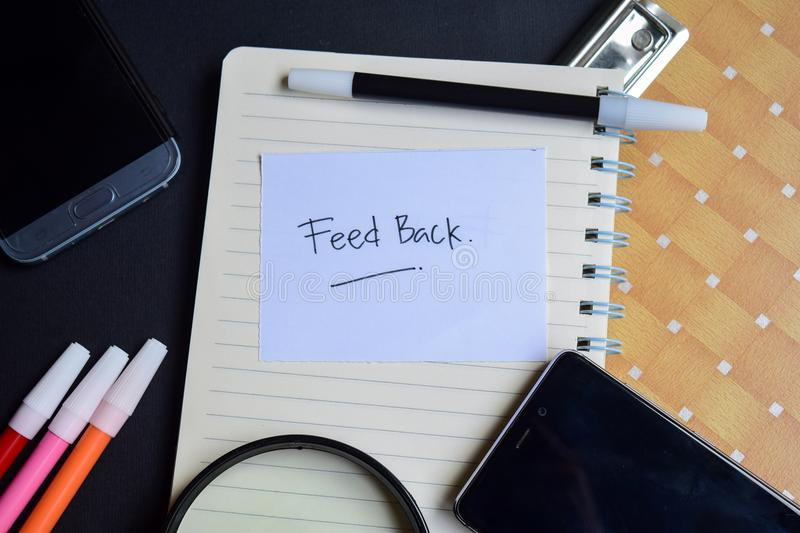 FeedBack word written on paper. FeedBack text on workbook, technology business concept royalty free stock photos