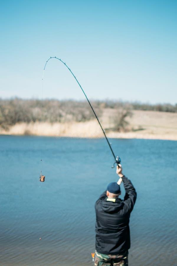 Free Feeder Fishing. Carp Fishing Steel Basket Bait Feeder On Rod Close Up. Male Fisherman Fishing At Sun Day On The Lake Royalty Free Stock Photos - 176736968
