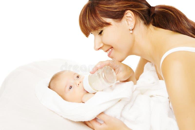 Feeding Baby. Newborn eating milk from bottle. Feeding baby. Newborn eating milk from bottle in Mother hand, white backgtound royalty free stock photos