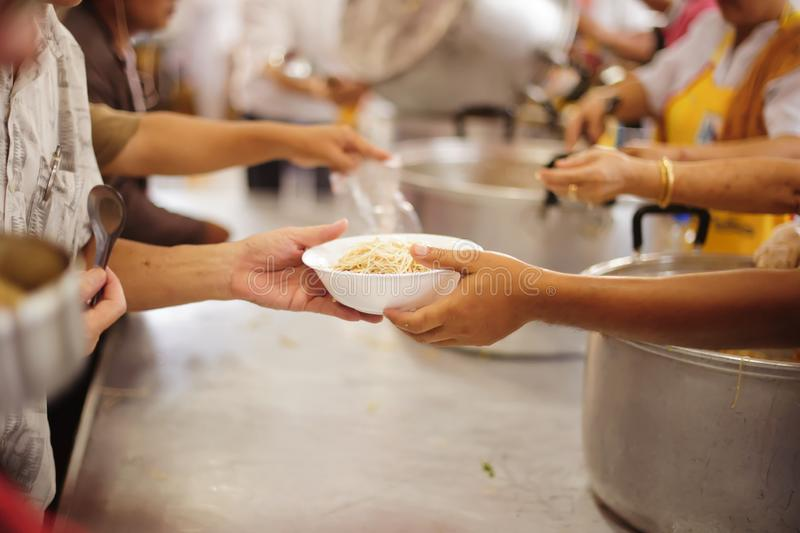 Feeding concept, Food donation, Helping people in society.  stock image