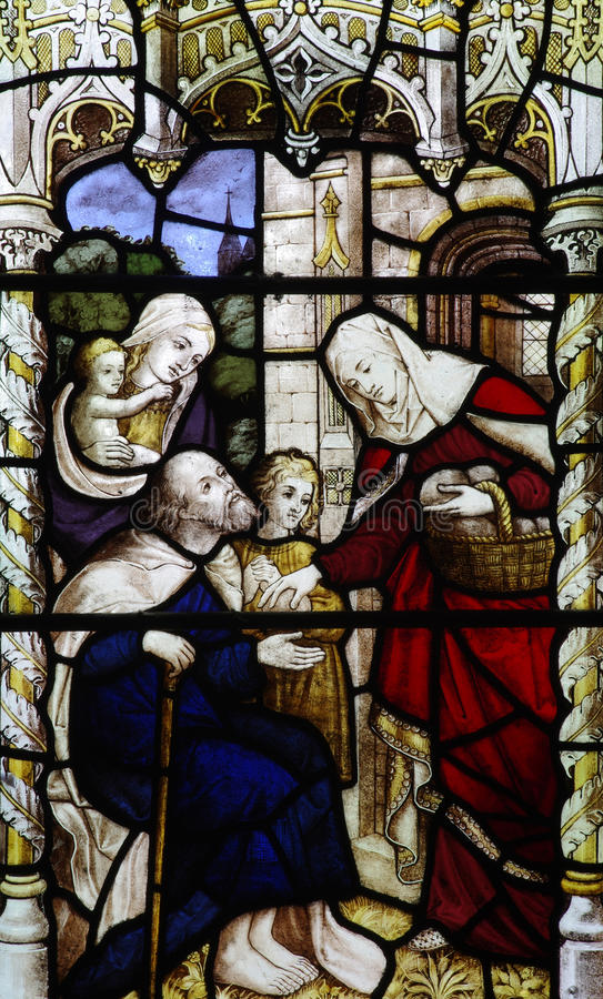 Feeding the poor (stained glass). A photo of feeding the poor (stained glass stock photography