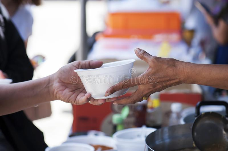 Feeding the poor to alleviate hunger. give concept royalty free stock photography