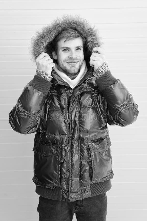 Feel comfortable in warm clothing. Keep warm. Comfortable winter clothing. Winter stylish menswear. Man bearded hipster. Wear warm jacket with fur yellow royalty free stock images