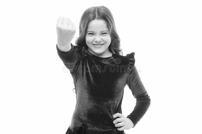 Feel my power. Girl kid threatening with fist isolated on white. Strong temper. Threatening with physical attack. Kids. Aggression concept. Aggressive girl stock photography