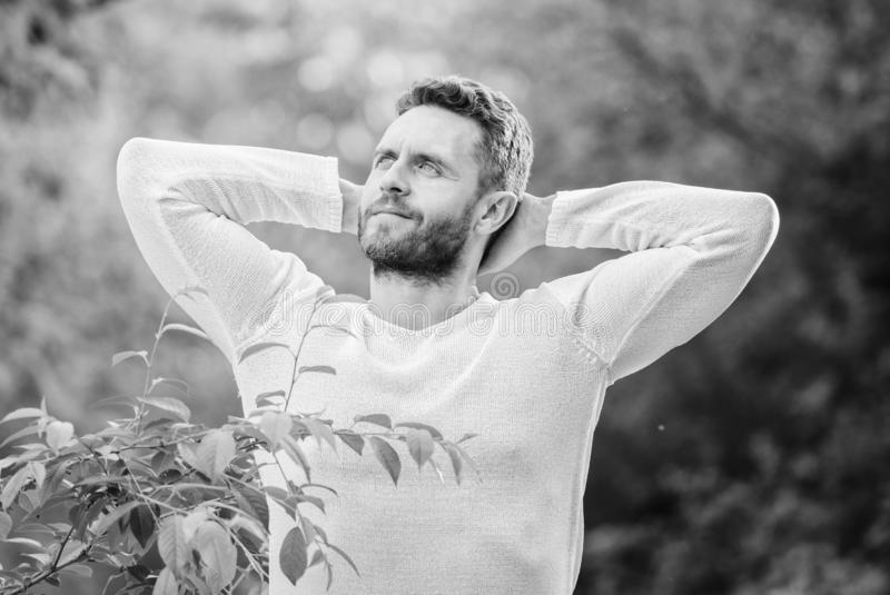 Feel power of nature. Man handsome bearded guy morning stretching nature background. Meet new day. Nature peaceful royalty free stock images