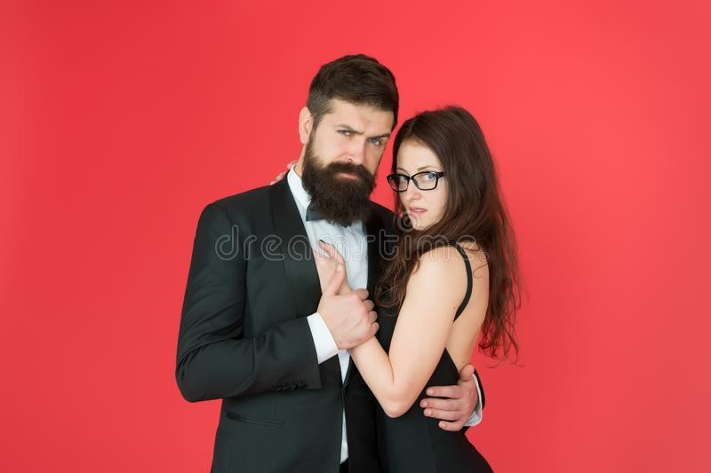 Feel rhythm of heart. Lets dance tonight. Elegant couple in love tender hug dancing red background. Happy together. Man stock photos