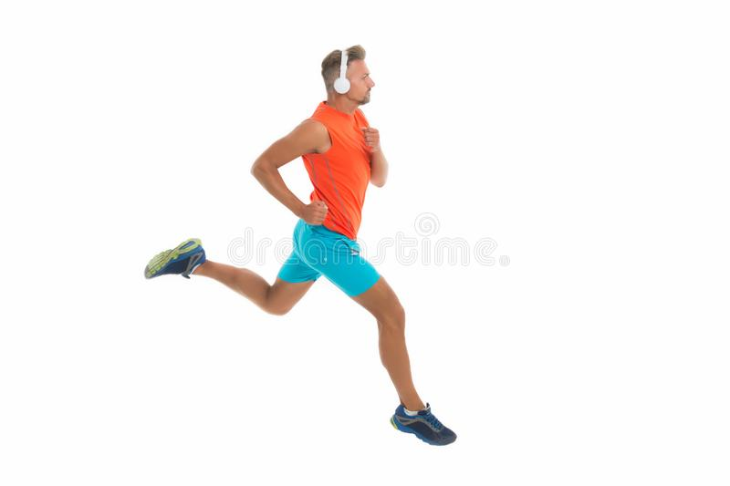 Feel the rhythm. Motivational song. Man sportsman running with headphones. Runner handsome strong guy motion isolated on royalty free stock photo