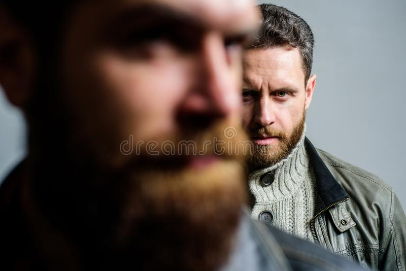 Feel support of real friend. Man bearded guy stand behind back of friend hipster. True friend always near. Someone. Behind you. Stand beside you. Friendship royalty free stock image