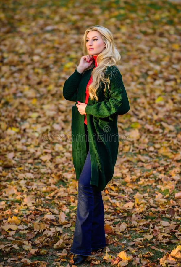 Feel so warm and comfortable. Autumn fashionable cardigan. Woman wear long wool cardigan while walk in park. Fall. Fashion warm cardigan. Girl stylish outfit royalty free stock photography