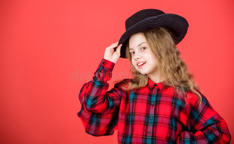 Feeling awesome in this hat. Girl cute kid wear fashionable hat. Small fashionista. Cool cutie fashionable outfit. Happy. Childhood. Kids fashion concept. Check stock photos