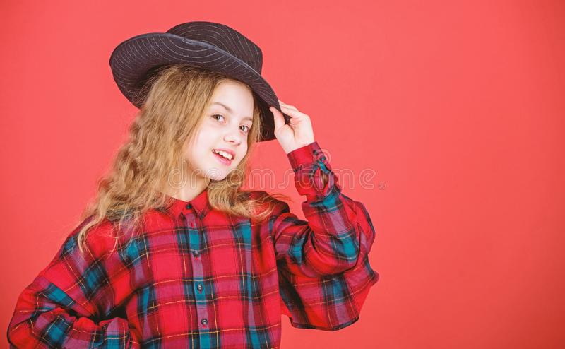Feeling awesome in this hat. Girl cute kid wear fashionable hat. Small fashionista. Cool cutie fashionable outfit. Happy. Childhood. Kids fashion concept. Check royalty free stock photo