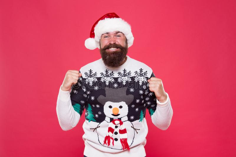 Feeling awesome successful cheerful. Christmas celebration. Emotional expression. Having fun. Happiness and joy. Celebration time. Emotional man Santa hat stock images