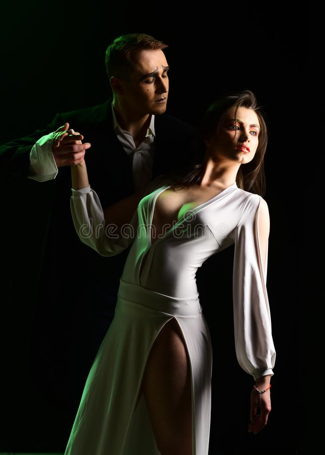 The feeling of being in love. Theatre actors miming through body motions. Mime man and woman act in romantic scene. The feeling of being in love. Theatre actors royalty free stock image