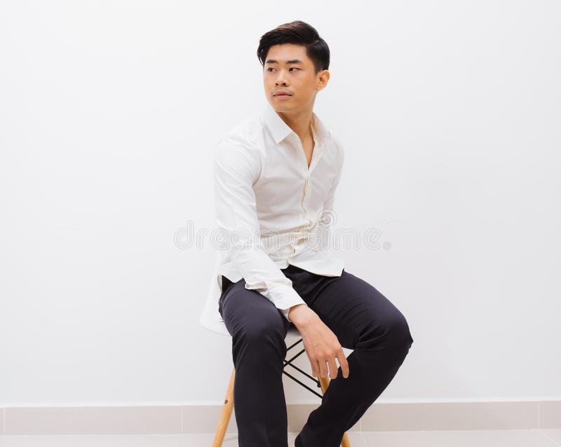 Feeling comfortable anywhere. Handsome young man looking at came royalty free stock image