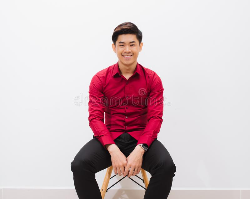 Feeling comfortable anywhere. Handsome young man looking at came royalty free stock photo