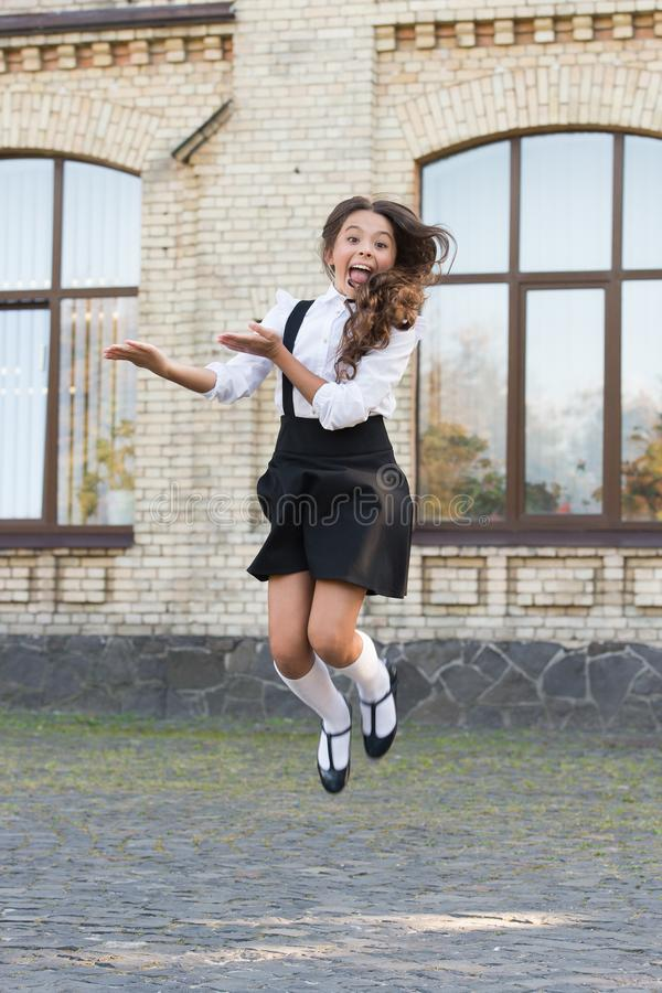 Feeling comfy. Girl wear fashionable outfit. White shirt and black dress. Formal clothes for visiting school. Daily. Outfit. Adorable schoolgirl. Perfect royalty free stock photography