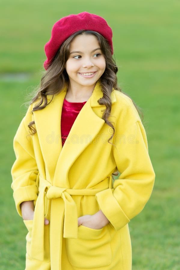 Feeling cozy and comfortable. Girl fashionable model wear yellow wool coat. Child in warm clothes. Fancy coat. Classic. Coat does not have to be boring but royalty free stock photography