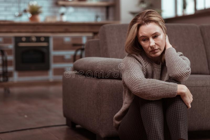 Woman wearing brown squared trousers feeling depressed. Feeling depressed. Woman wearing brown squared trousers feeling depressed after work problems stock photography