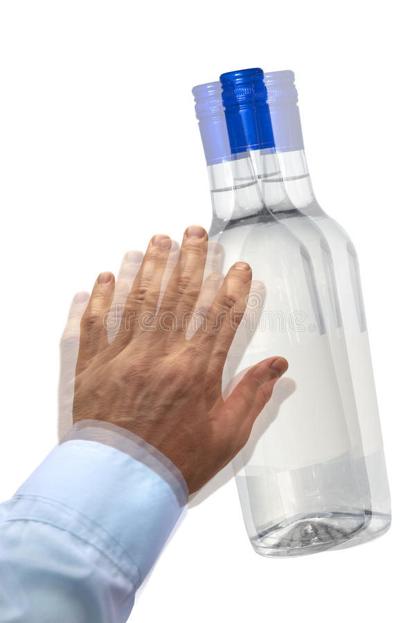 Feeling drunk. Vision blurred by alcohol, spirits bottle with blank label royalty free stock photo