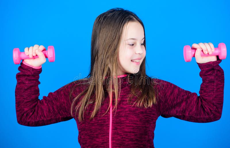Feeling energy inside. Happy child with barbell. Fitness for energy health. workout of small girl hold dumbbell. weight. Lifting for muscules. Sport success royalty free stock image