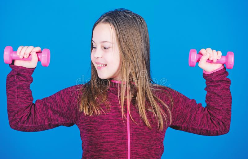 Feeling energy inside. Happy child with barbell. Fitness for energy health. workout of small girl hold dumbbell. weight. Lifting for muscules. Sport success stock photography