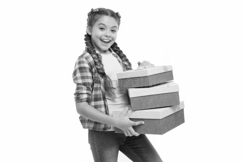 Feeling so excited. Small cute girl received holiday gift. Best toys and birthday gifts. Kid little girl in with braids. Hold gift box white background. Child royalty free stock photos