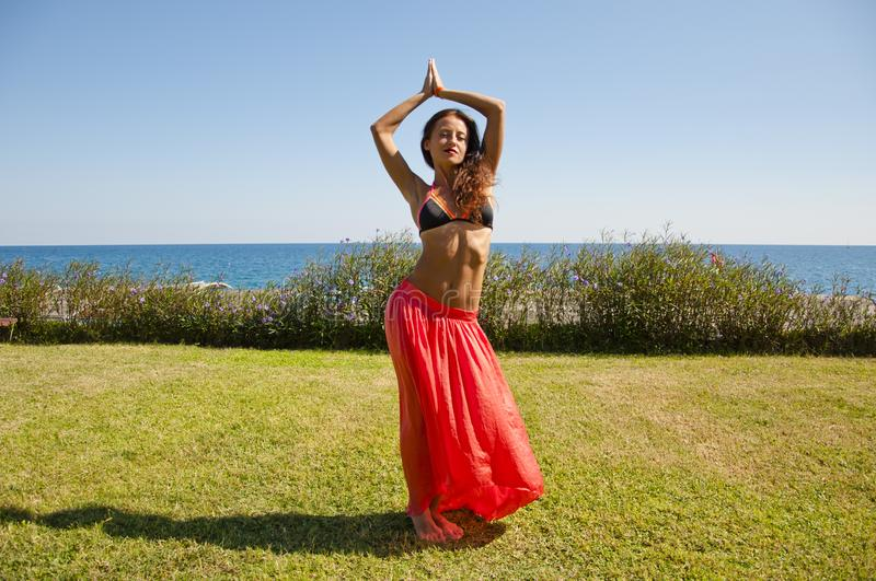 Feeling flirty. Sensual girl on sea beach. Eastern beauty. woman with fit belly. Spa and relax. Perfect body of belly dancer stock images
