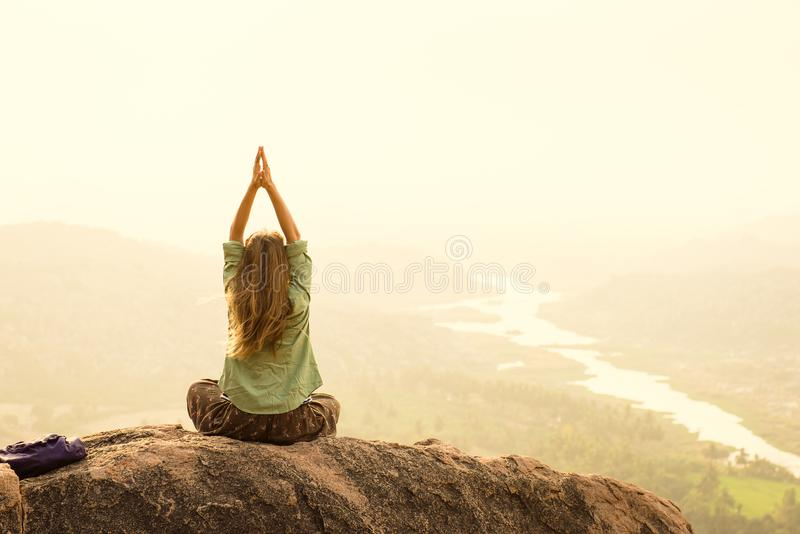 Feeling of freedom and freshness during morning meditation in I royalty free stock image