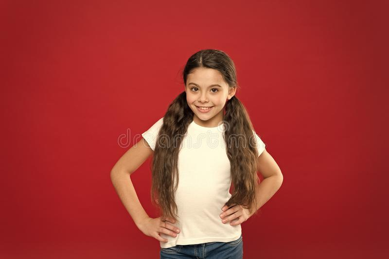 Feeling good fabulous hair. Pretty girl smile with new hairstyle. Happy girl with stylish ponytail hairstyle. Little royalty free stock images