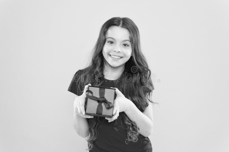Feeling grateful for good gift. Surprise and pleasant present box. Child happy hold gift box. Kid girl delighted gift stock photo