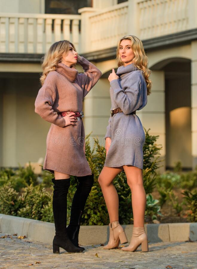 Feeling great. warm oversized clothes. sexy women sunny weather outdoor. free style comfortable. autumn fashion. blond royalty free stock photos