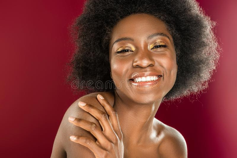 Joyful happy afro American woman smiling to you royalty free stock images