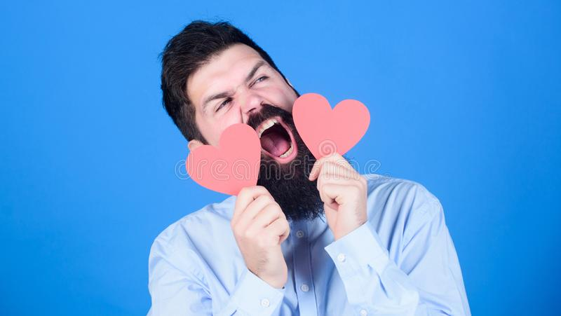 Feeling love. Dating and relations concept. Happy in love. Making man feel loved. Man bearded hipster with heart. Valentine card. Celebrate love. Guy attractive royalty free stock photos