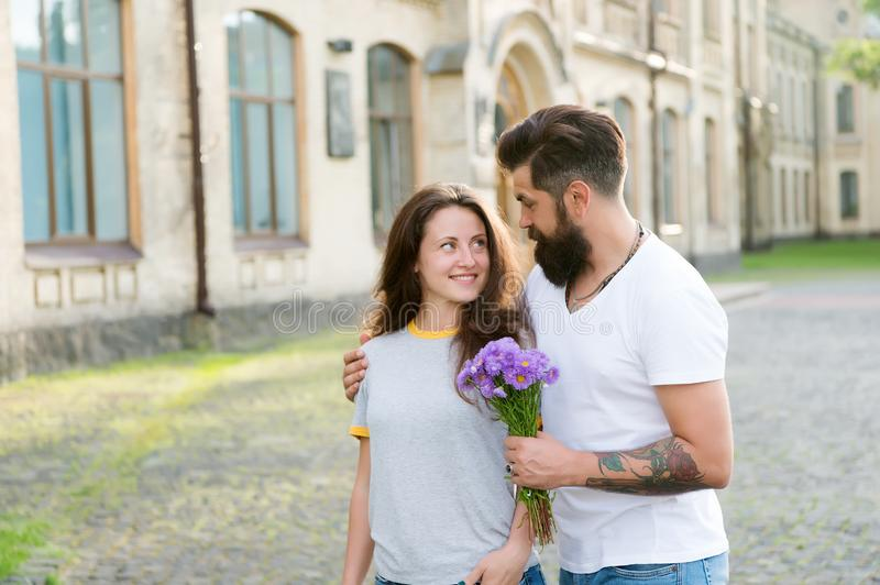 Feeling of love. Man bearded hipster hugs woman. couple in love. Bearded hipster fall in love. valentines day concept stock photography