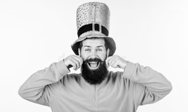 Feeling playful. Happy bearded man celebrating saint patricks day. Irish man with beard wearing green. Hipster in royalty free stock photo