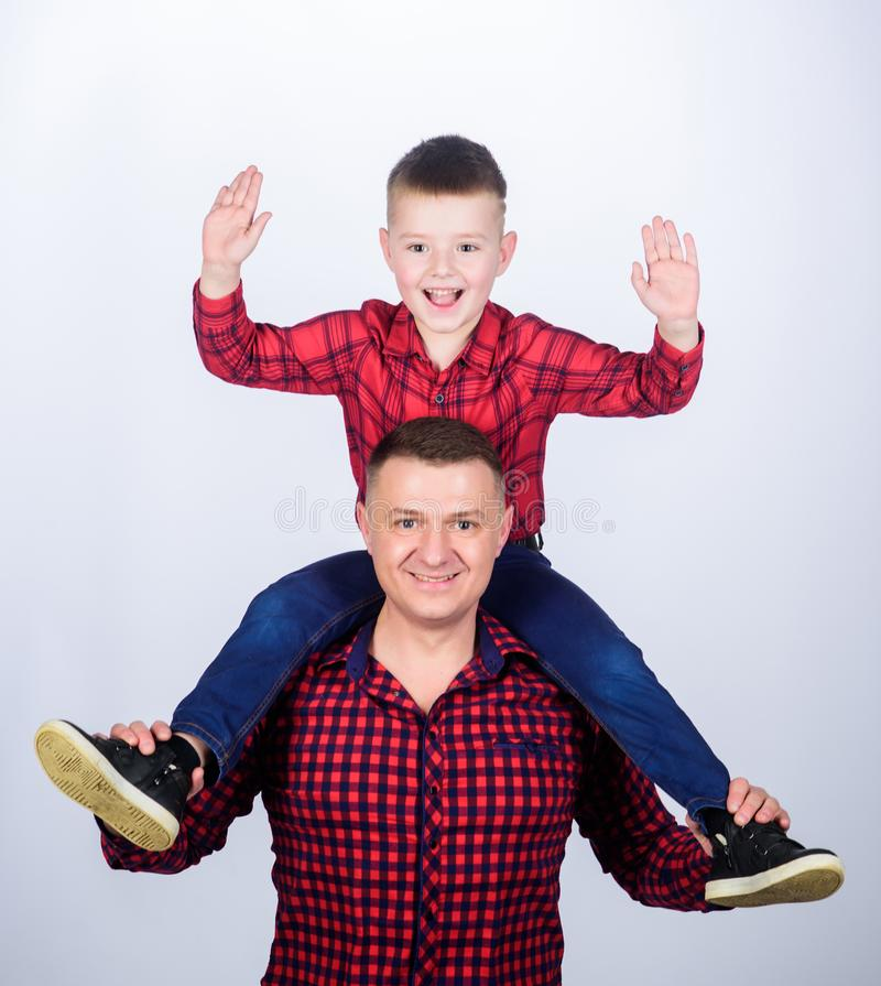Feeling playful. take fife. take five to success. leisure time. fathers day. father and son in red shirt. happy family. Little boy with dad man. childhood stock image