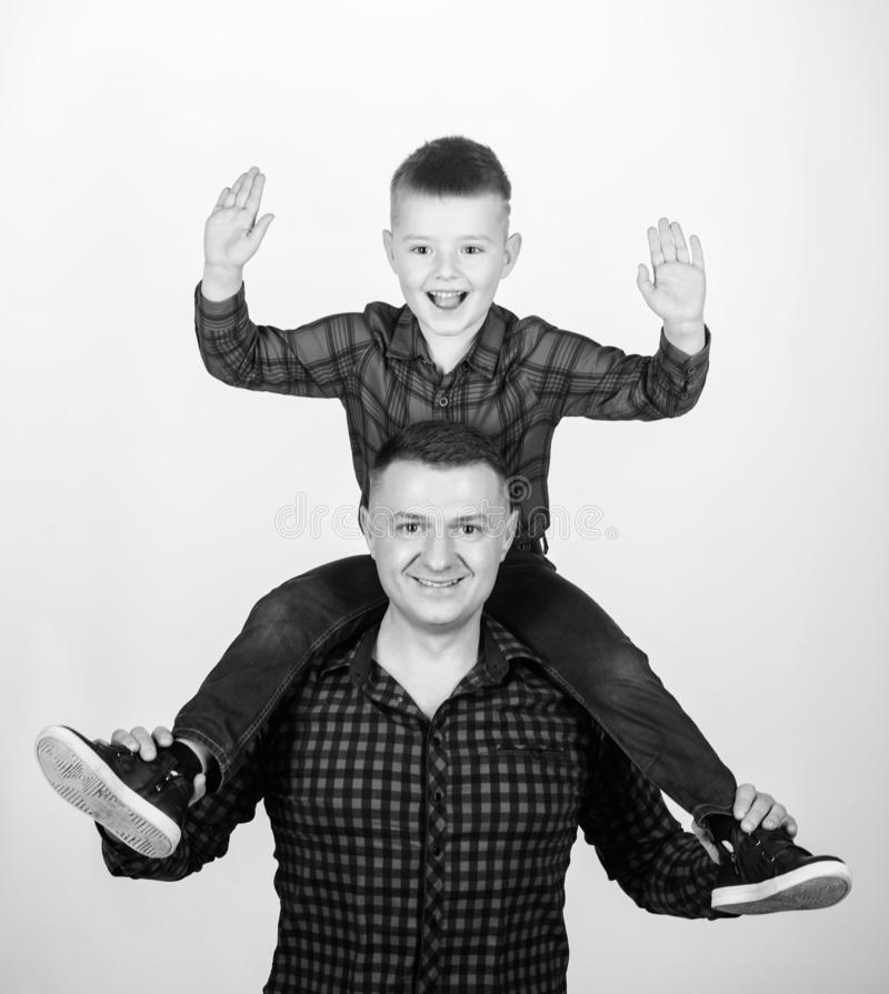 Feeling playful. take fife. take five to success. leisure time. fathers day. father and son in red shirt. happy family. Little boy with dad man. childhood royalty free stock image