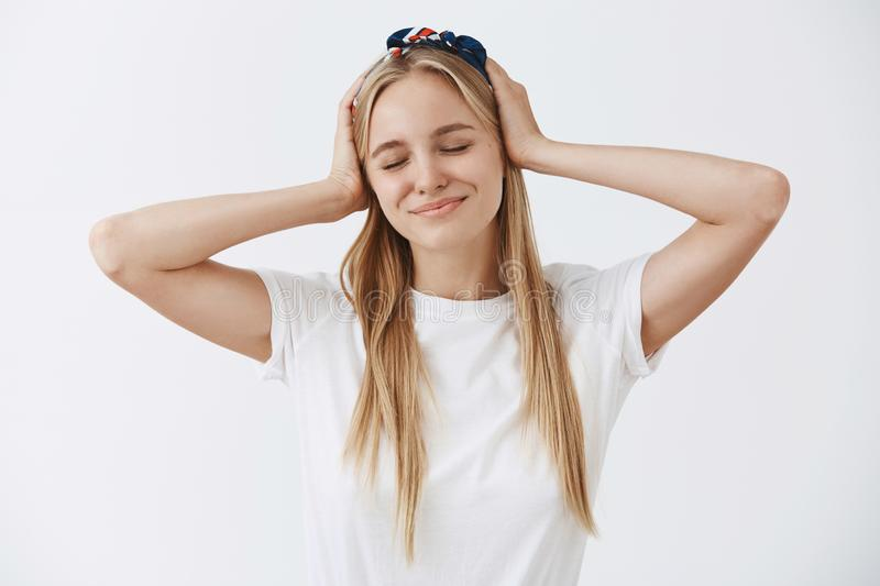 Feeling pretty and fresh today, lucky to have clear skin. Carefree happy and tender young european woman in headband royalty free stock photography