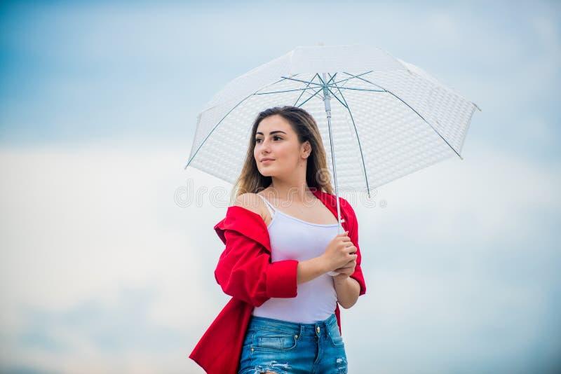 Feeling protected. Wind of change. Pretty woman with light umbrella. Rainbow umbrella. Rainy weather. Good mood. Good royalty free stock photo