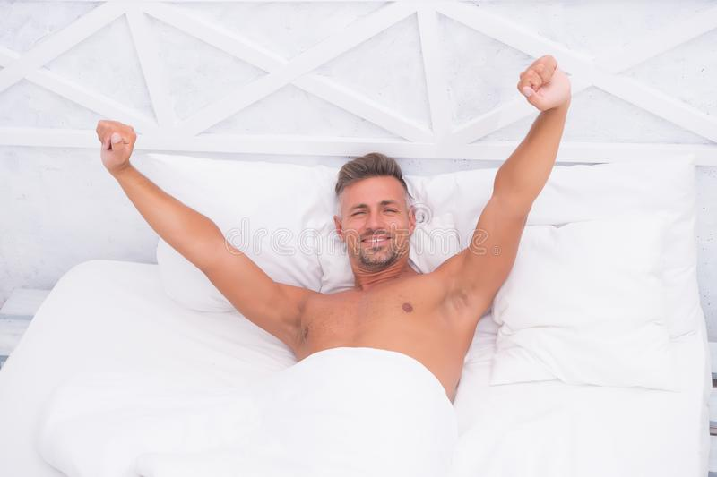 Feeling recharged. Healthy habits. Man handsome guy lay in bed sleeping. Tips sleeping better. Bearded peaceful man royalty free stock image