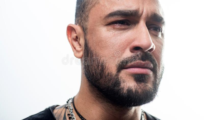 Feeling sad and crying. Sad man. Unhappy hispanic man with tears on sad face. Suffering handsome latino guy being sad royalty free stock photography