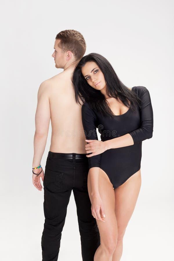 Feeling secure. Girl feeling secure behind man's back royalty free stock image