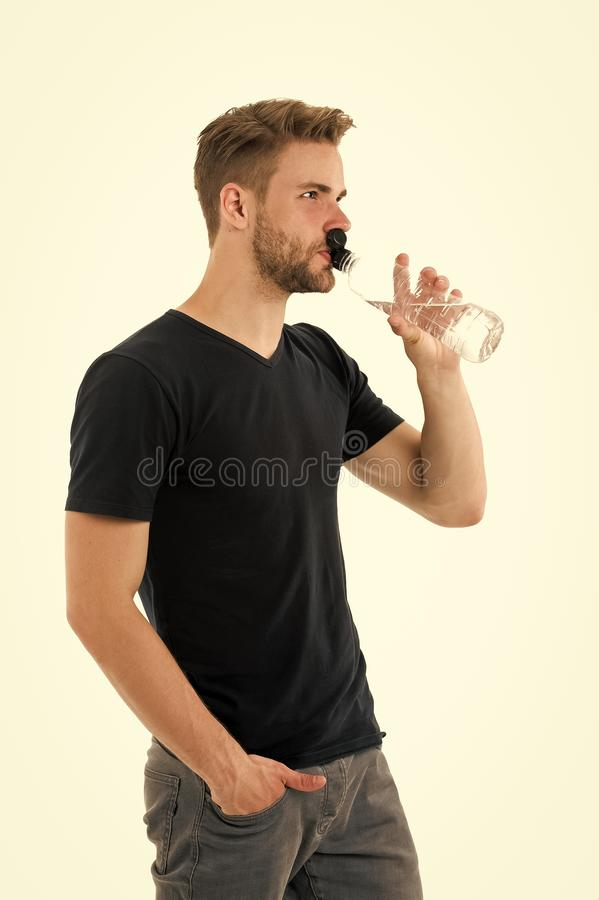 Feeling thirsty. Man athlete hold water bottle. Guy drink water on white background. Man care health and water balance royalty free stock image