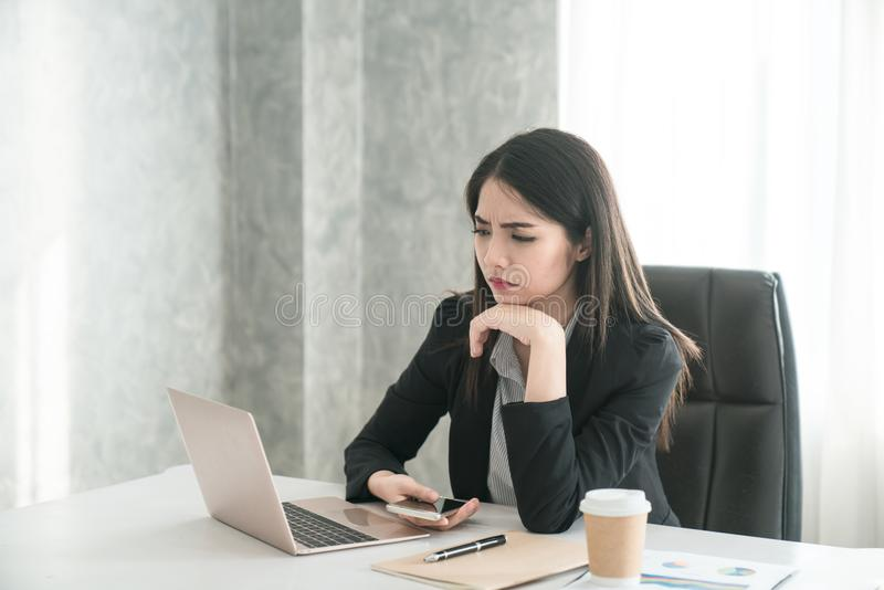 Feeling tired and stressed A young woman while sitting at her workplace at work. stock photos